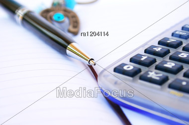 Calculator Pen And Notebook Stock Photo