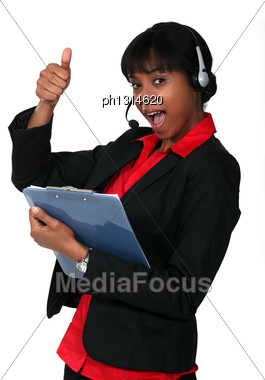 Call Centre Supervisor Giving The Thumb's Up Stock Photo
