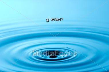 Calmness Concept. Circles On The Blue Water Stock Photo