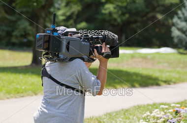 Camera Man in Action Stock Photo