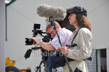 Cameraman And Sound Recordist At Work Stock Photo