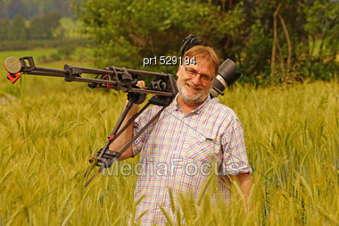 Cameraman At Work In A Wheat Field Stock Photo