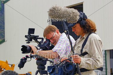 Cameraman And Sound Recordist At Work On Ocation Stock Photo