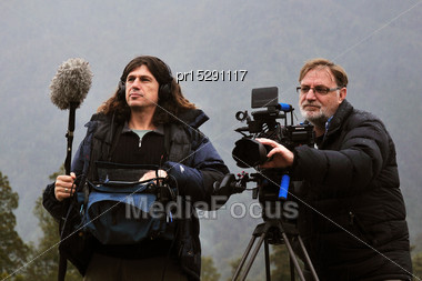 Cameraman And Sound Recordist At Work On The West Coast, New Zealand Stock Photo