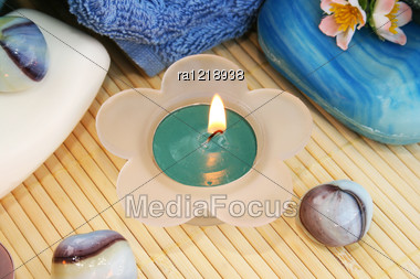 Candle, Soaps, Stones Closeup Picture. Stock Photo