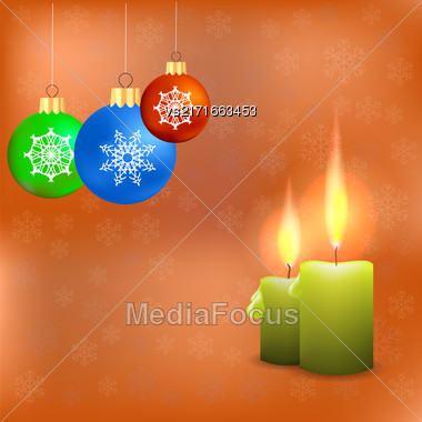 Candles And Colorful Glass Balls Isolated On Orange Snowflakes Background. Winter Pattern Stock Photo