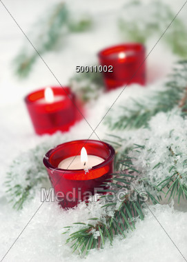 Candles on Snowy Branch Stock Photo