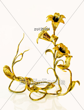 Candlestick In The Form Of Lilies . Stock Photo