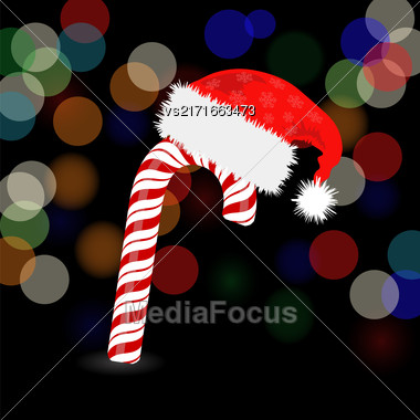 Candy Cane And Hat Of Santa Claus 0n Dark Blurred Background Stock Photo