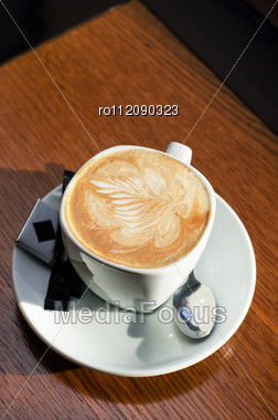 Cappuccino Coffee Cup Closeup At The Table Stock Photo