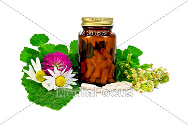Capsules In A Brown Sealed Jars And Sprigs Of Mint, Flowers Of Chamomile, Clover, Mignonette, Sage Leaf Stock Photo