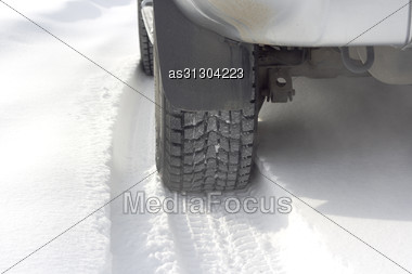 Car Tires On The Winter Road Stock Photo