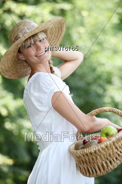 Carefree Woman With A Straw Hat Stock Photo