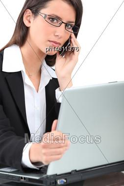 Careful Woman On Phone Stock Photo
