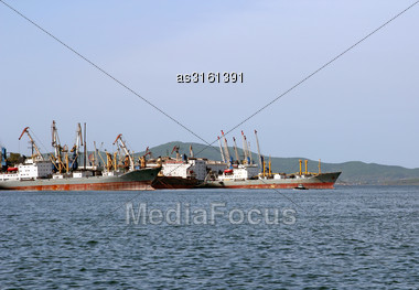 Cargo Ships Are In Port For Loading Stock Photo