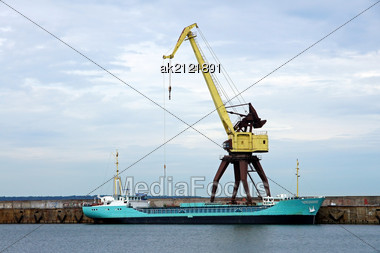 Cargoship And The Crane On A Background Of The Sky Stock Photo