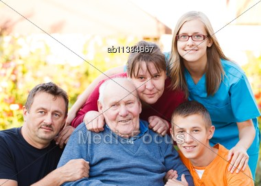 Caring Doctor Together With Her Patient's Family Stock Photo