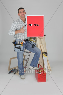 Carpenter Giving The Thumbs-up Gesture Stock Photo