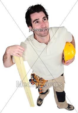 Carpenter Holding Plank Of Wood Stock Photo