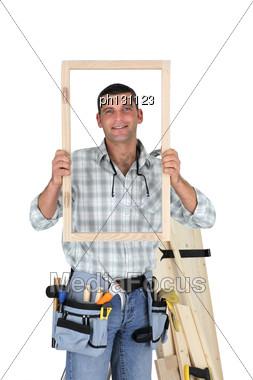 Carpenter Showing Wood Frame Stock Photo
