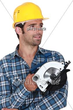 Carpenter Stood Holding Circular Saw Stock Photo