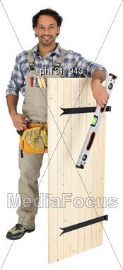 Carpenter Stood With Wooden Door Stock Photo