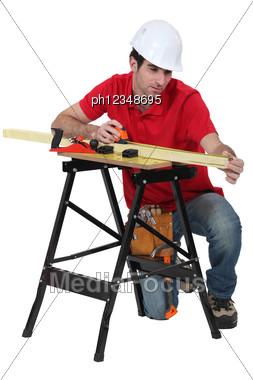 Carpenter Taking Measures. Stock Photo