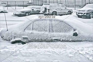 Cars Covered With Snow In The Winter Blizzard Stock Photo