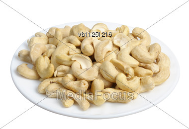 Cashew Nuts In A White Plate Stock Photo