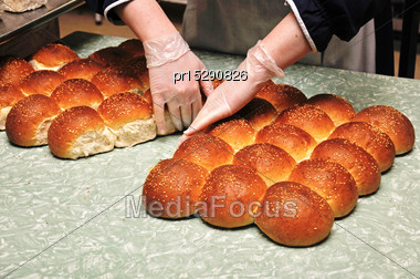 Caterer Separates Freshly Baked Buns For Guests At A Reception Stock Photo