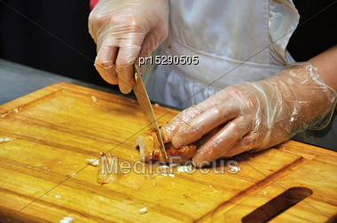 Caterer Slices Up Chicken Breasts For Meals At A Reception Stock Photo