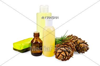 Cedar Oil In A Bottle, Two Cedar Cones, Two Green Homemade Soap, Body Lotion, Shower Gel Stock Photo