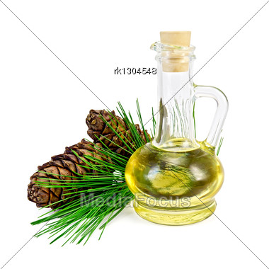 Cedar Oil In A Glass Bottle, A Sprig Of Cedar With Two Cones Stock Photo