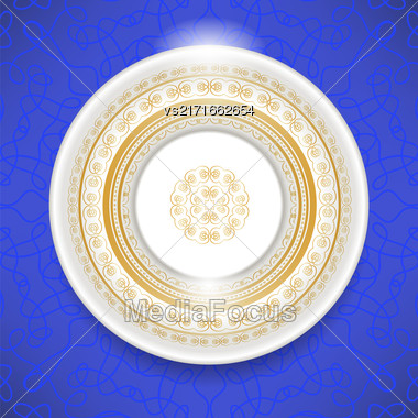 Ceramic Ornamental Plate Isolated On Blue Background. Top View Stock Photo