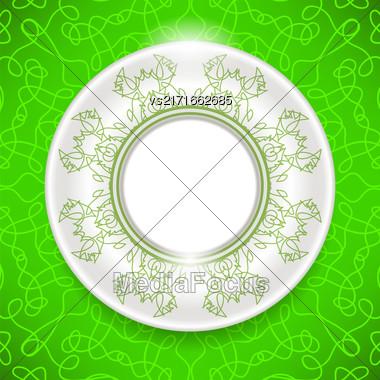 Ceramic Ornamental Plate On Green Background. Top View Stock Photo