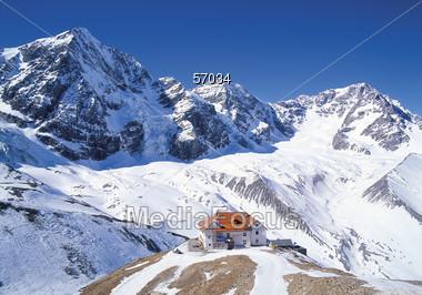 Chalet on Mountain Top Stock Photo