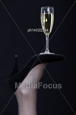 Champagne Glass Balanced On The Sole Of A Shoe Stock Photo