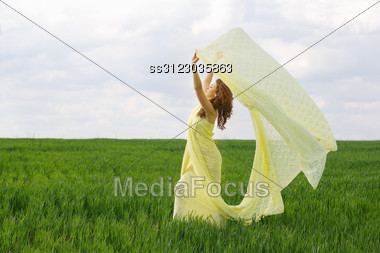 Charming Girl Dancing In A Green Field Stock Photo