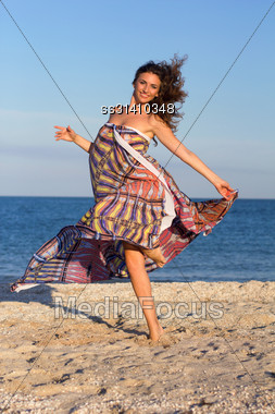 Charming Young Woman Having Fun On The Beach Stock Photo