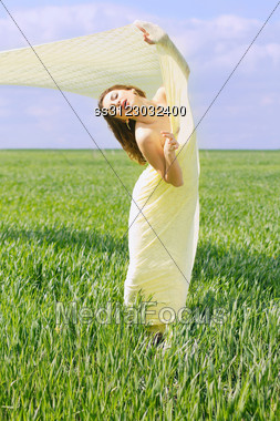 Charming Young Woman Wrapped In Yellow Cloth Stock Photo