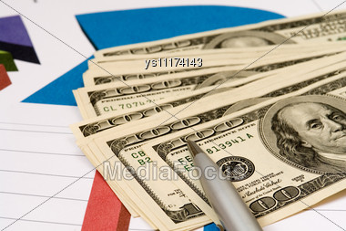 Chart With Money And Pen Stock Photo