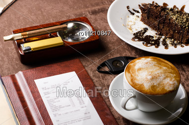 Check, Ashtray, Cigar, Lighter And Coffee At Restaurant Table Stock Photo