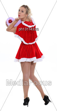 Cheeky Miss Santa Looking Over Her Shoulders Stock Photo