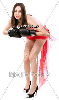Cheeky Young Woman Posing In Boxing Gloves. Isolated On White Stock Photo