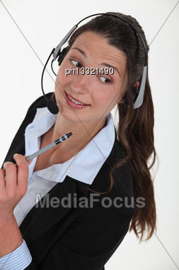 Cheerful Brunette Call-center Worker Stock Photo