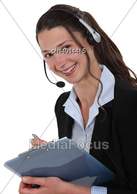 Cheerful Call-center Supervisor With Clip-board Stock Photo