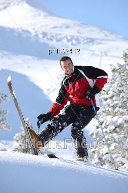 Cheerful Man Skiing Stock Photo