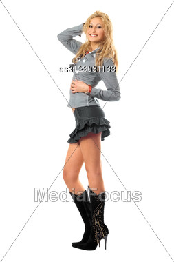 Cheerful Pretty Blonde In A Gray Skirt Stock Photo