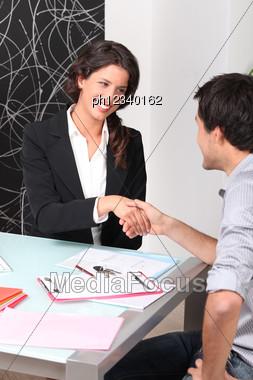 Cheerful Woman And Man Handshaking Stock Photo