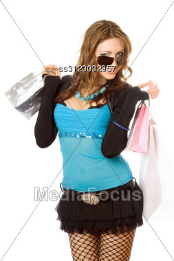 Cheerful Young Woman After Shopping. Stock Photo